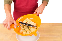 Mashing potatoes Stock Images