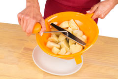 Mashing potatoes Stock Photos