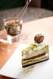 Mashmallow matcha green tea cake with macaron Stock Photo