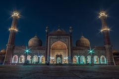 The Masjid-i Jahān-Numā also known as the Jama Masjid in Delhi at blue hour during month of Ramadan stock photo
