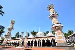 Masjid Jamek Kuala Lumpur. Kuala Lumpur,Malaysia - February 16, 2014: Tourists can seen exploring around the Masjid Jamek mosque which is located at the heart of royalty free stock photography