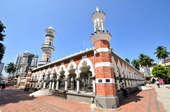 Masjid Jamek Kuala Lumpur. Kuala Lumpur,Malaysia- February 16, 2014: Tourists can seen exploring around the Masjid Jamek mosque which is located at the heart of royalty free stock image
