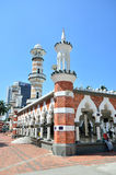 Masjid Jamek Kuala Lumpur. Kuala Lumpur,Malaysia- February 16, 2014: Tourists can seen exploring around the Masjid Jamek mosque which is located at the heart of royalty free stock images