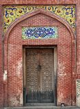 Masjid Wazir khan Traditional Gate. Architecture of Masjid Wazir Khan, an old patterned gate of wood alongwith colorful tiled work Stock Images