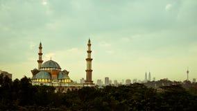 Masjid Wilayah Persekutuan. KUALA LUMPUR, MALAYSIA - 19TH OCTOBER 2014; Sunrise at the Federal Territory Mosque or Masjid Wilayah Persekutuan, a major mosque in Royalty Free Stock Images