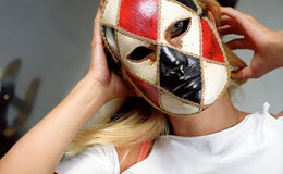 Mask. Woman wearing carnival mask Stock Photography