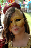 Mask. Beautiful princes with a golden mask Stock Images