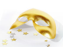Mask. Gold party mask with stars Royalty Free Stock Photo