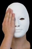 The mask. White mask on black background with eye and hand Stock Photos