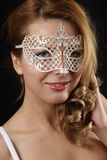 Mask. Young girl with a mask on face Royalty Free Stock Photo