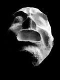 Mask. White gypsum mask on a black background Royalty Free Stock Photography