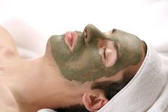 MASK. Someone having a mud mask in a spa Stock Photography