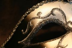 Mask. Part of a black and silvery mask on black Royalty Free Stock Photography