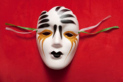 Mask. Colorful   mask isolated on red background Royalty Free Stock Photography