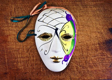 Mask. Decorative mask on a wooden background Stock Photo