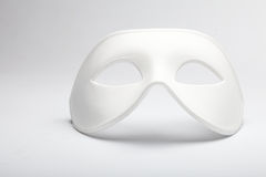 Mask. White mask on the glass stock photos