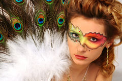 Mask. Lady with fantasy makeup and peacock's fun Royalty Free Stock Photos