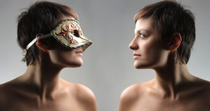 Mask. Two specular portrait of a woman Royalty Free Stock Photo