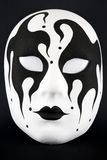The mask. Black and white harlequin mask Stock Images