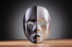 Mask against. The dark background Stock Photos
