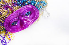 Mask and beads Stock Photo