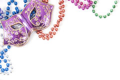 Mask and beads with copyspace Royalty Free Stock Photography