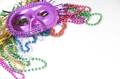 Mask and beads with copyspace. Mardi gras mask and beads Stock Photography