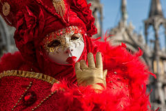 Mask in beautiful red costume at carnival in Venice Royalty Free Stock Photography
