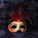 Mask at a black velvet seat (Venice, Italy) stock images
