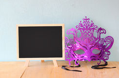Mask and blackboard, room for text Stock Photography