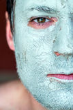 Mask of blue clay on men face Royalty Free Stock Photos