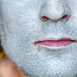 Mask of blue clay on men face Royalty Free Stock Photography