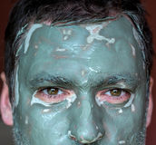 Mask of blue clay on men face Stock Photography