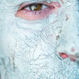 Mask of blue clay on men face Stock Photos
