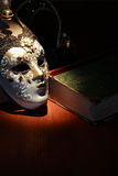 Mask And Book Stock Images
