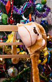 Mask-cap monkey on a background of the Christmas tree Royalty Free Stock Photography