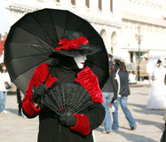Mask on a carnival. A costumed woman in black and red on a Venetian carnival Royalty Free Stock Photo