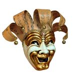 Mask, carnival, Venice. In a mask musical sheets are used.The mask is made in 21 century stock images