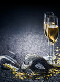Mask and champagne with star shaped confetties and copy space Royalty Free Stock Photography