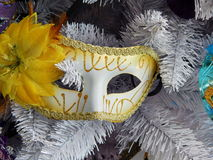 A mask on the Christmas tree. Christmas toys background. Royalty Free Stock Photography