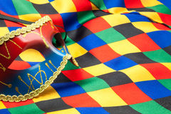 Mask and cloth of harlequin. For a disguise Stock Images