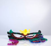 Mask with colored beads on white background Royalty Free Stock Photography