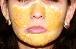 Mask compress on the skin of the face therapeutic propolis. lotions stock photography
