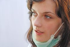 Mask down. Working woman with medical mask Stock Photos