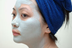 Mask on face. A chinese young lady with mask on face Stock Image