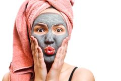 Mask for skin woman, funny and happy girl with facial mask on a white background, photo, girl blows her lips stock image