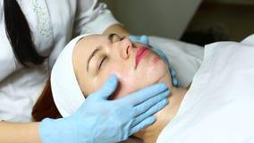 Mask facial. Woman passes treatment mask facial at the beauty salon stock footage