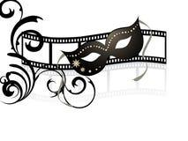 Mask on filmstripe Royalty Free Stock Images