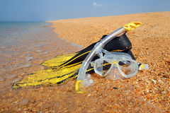 The Mask and The Fins on The Beach stock photos