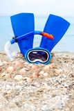 Mask, fins and tube in sand background Royalty Free Stock Photography